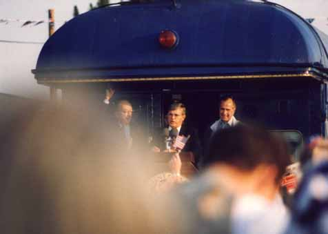 A photo of N.C. Governor Jim Martin addressing the crowd during President George Bush's Campaign '92 whistle-stop in Burlington, NC