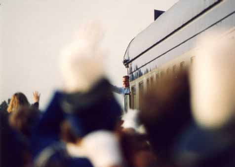 A photo of President George Bush waving to the crowd as he arrives for his Campaign '92 whistle-stop in Burlington, NC