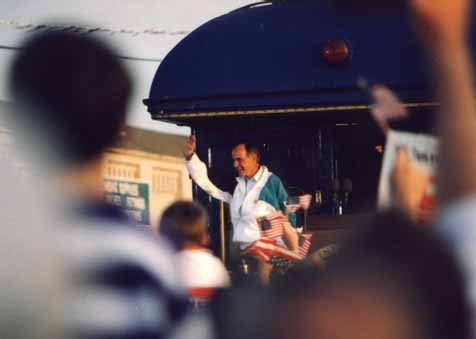 A photo of President George Bush waving to the crowd at his Campaign '92 whistle-stop in Burlington, NC