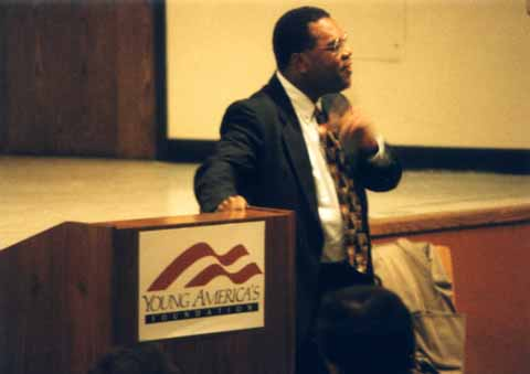 A photo of Horace Cooper making a point during his UNCG speech 