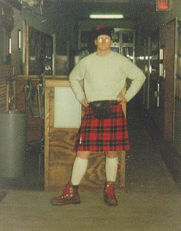 A photo of The Compleat Heretic wearing his kilt in the tartan of his clan and lacking only a claymore